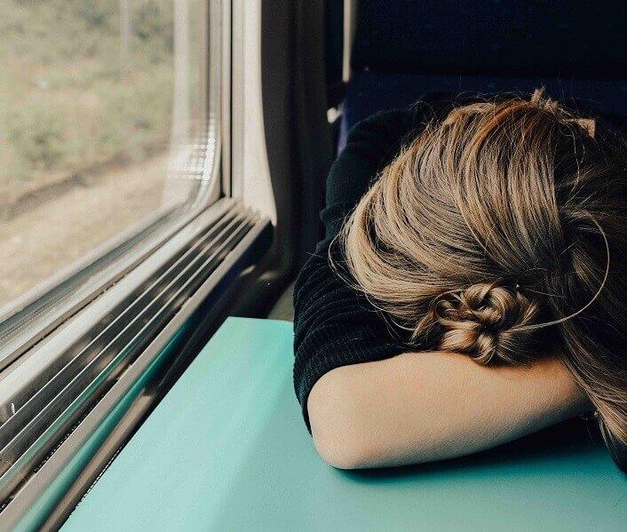 Woman asleep on a train