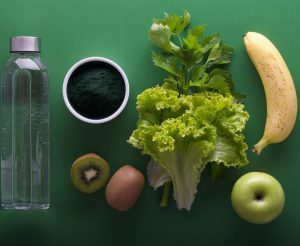A selection of vegetables, fruit and water
