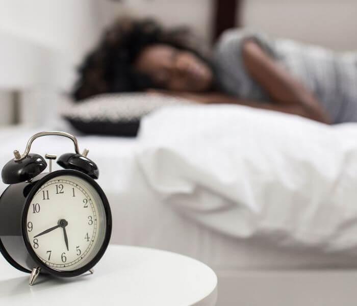 alarm clock on a bedside table